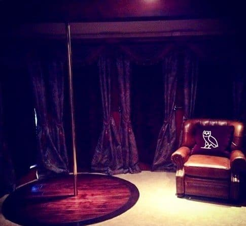 private back room at strip club, with arm chair a dancing pole and velvet curtains