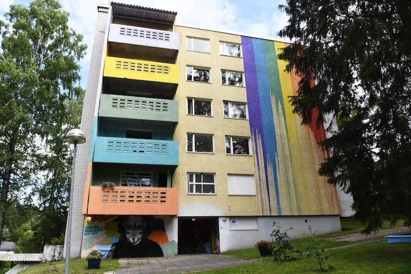colorful balconies and walls on the side of a condemned building