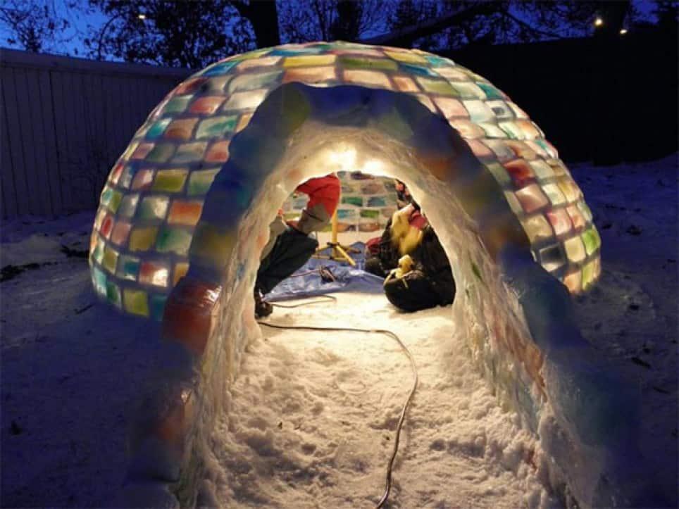 couple having a date insade an igloo in their backyard