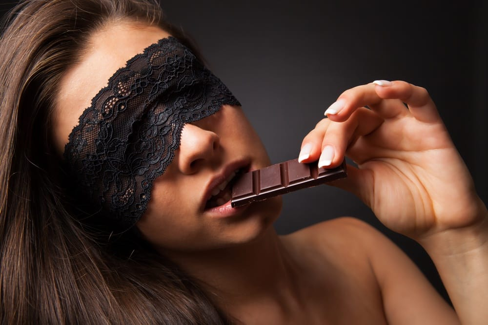 sex with food - woman eating chocolate