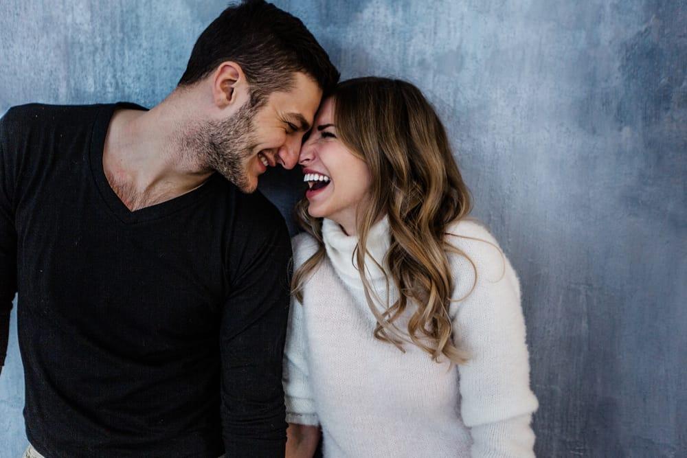 happy couple big laugh