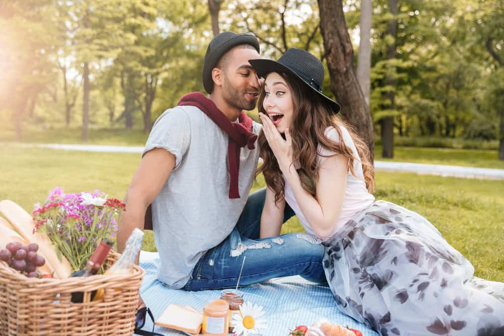 woman man talking picnic