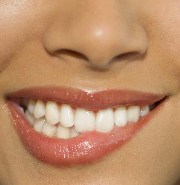 close up on woman's mouth biting her lip