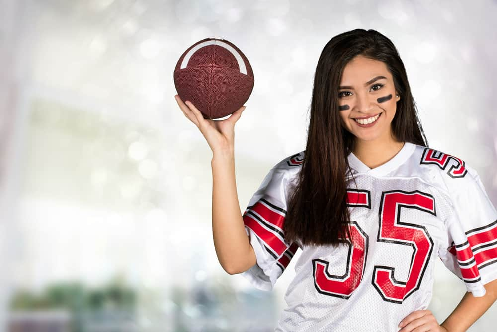 woman in a football gear