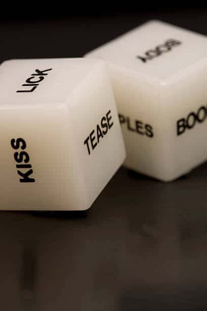 sexy couples game dice with sides that say, kiss, lick, tease, boobs, body, etc
