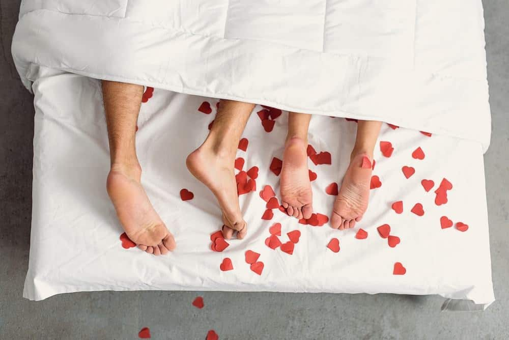 couple in bed with hearts