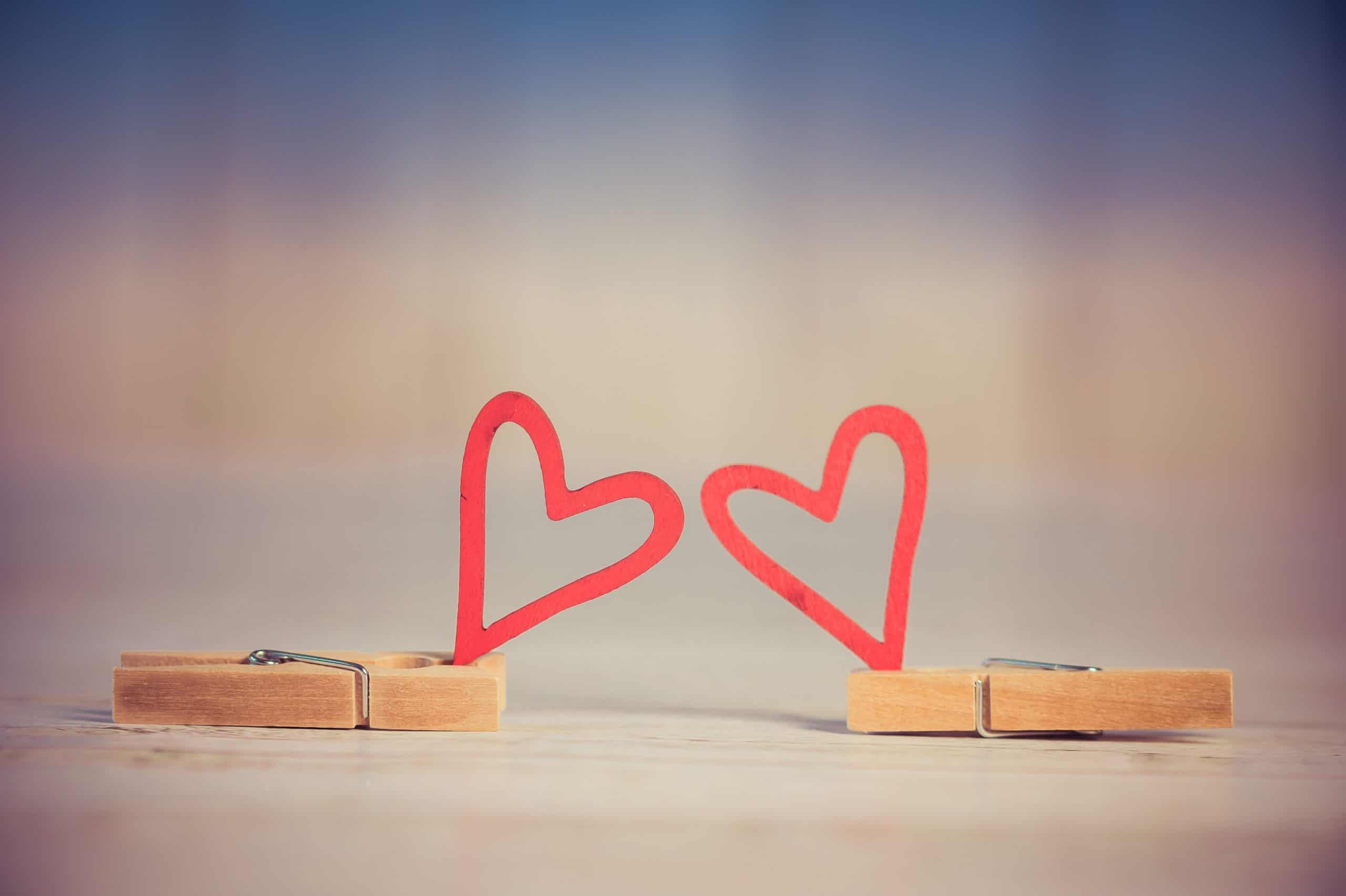 paper clips holding paper hearts