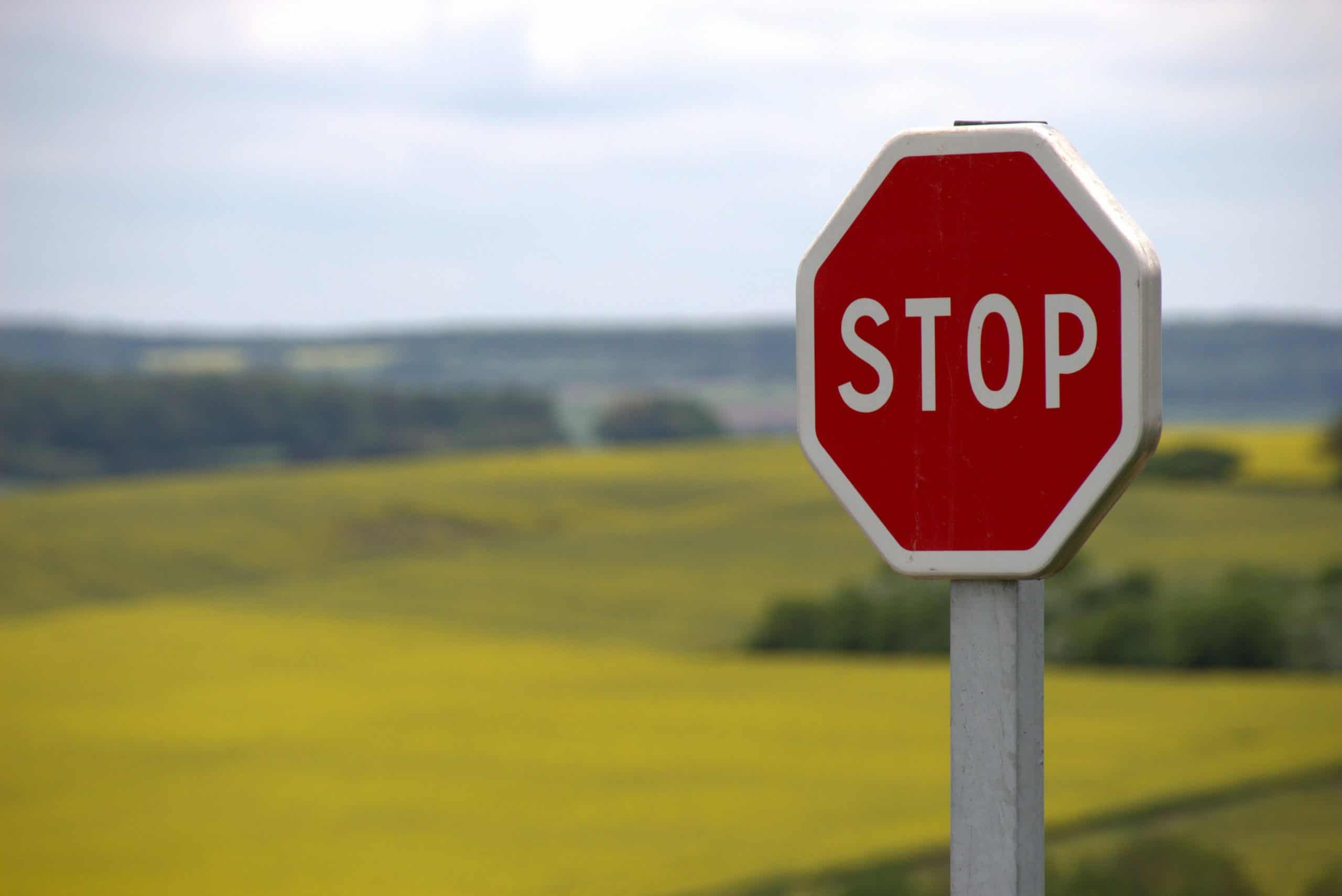 stop sign in front of a field