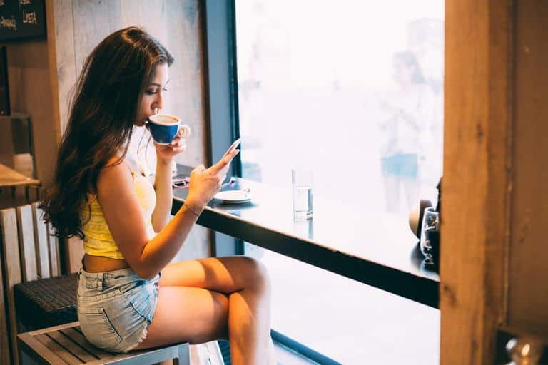 woman waiting and texting