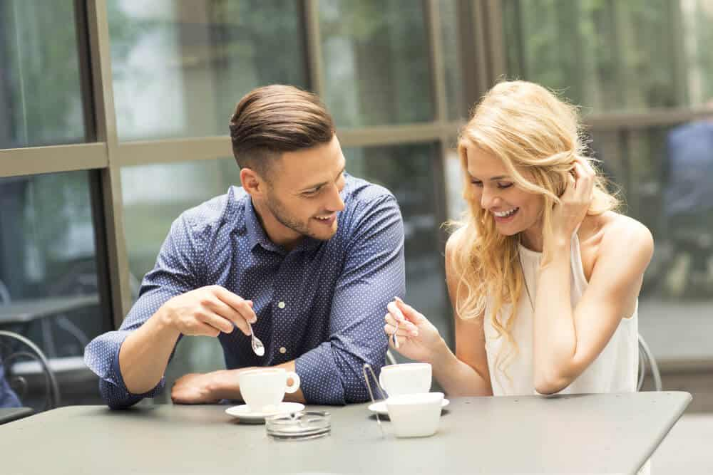 Beautiful couple having coffee