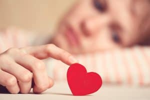 woman in love holding a paper heart