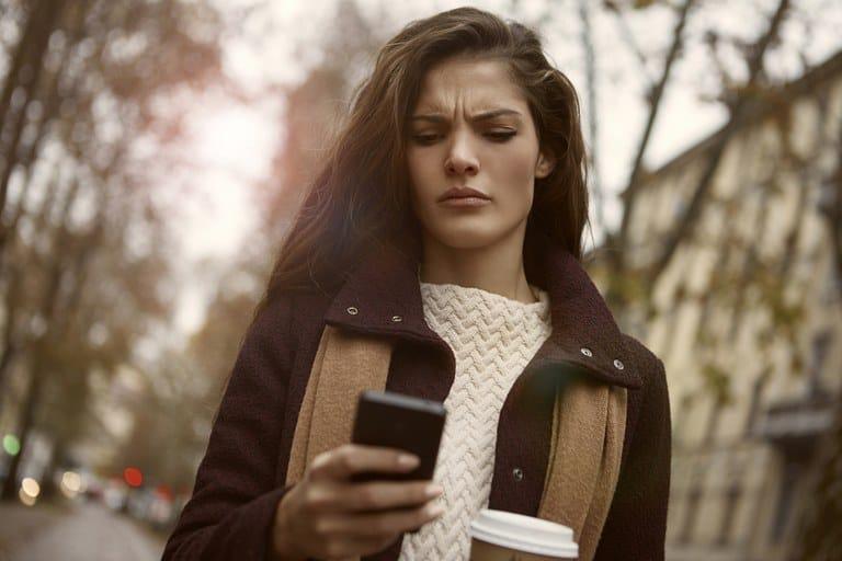 girl looking angrily at the phone