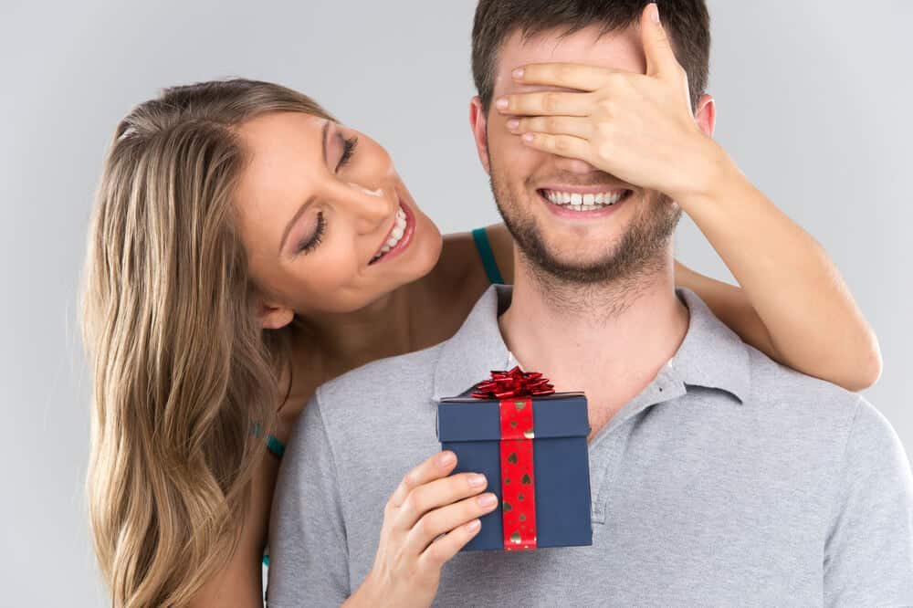 Woman surprises man with a birthday gift