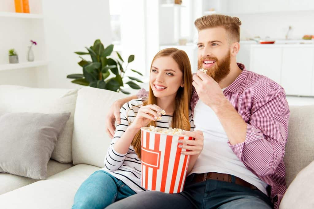 couple sofa popcorn