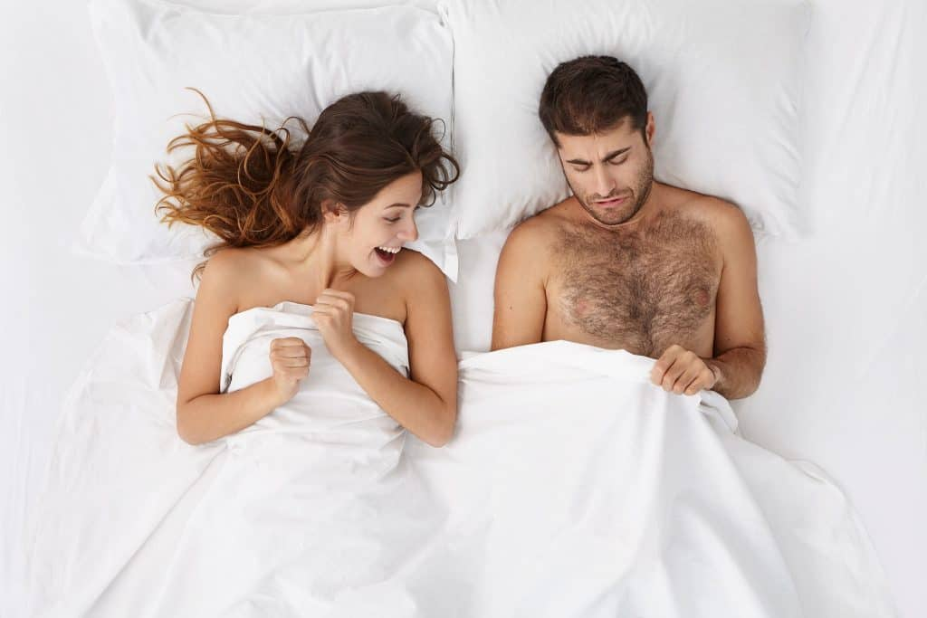 man woman bed blanket peeping
