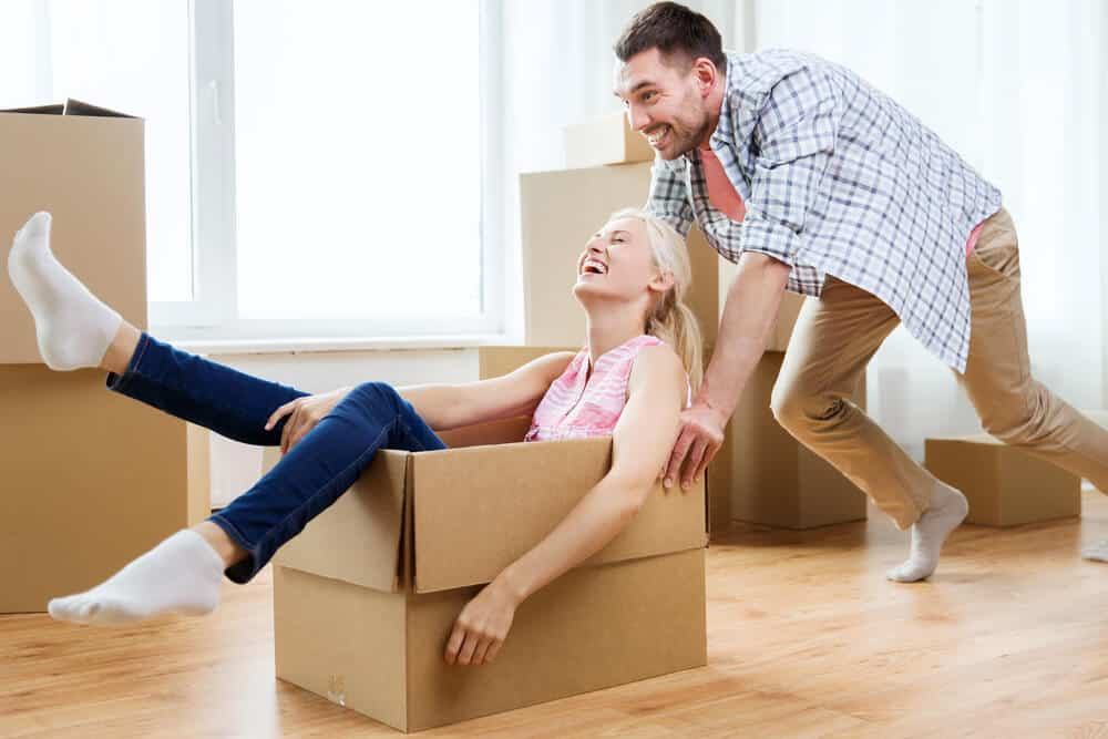 man pushing woman in a box