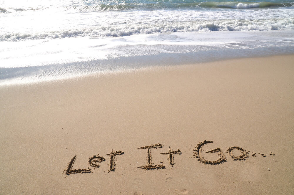 letting go message on sand