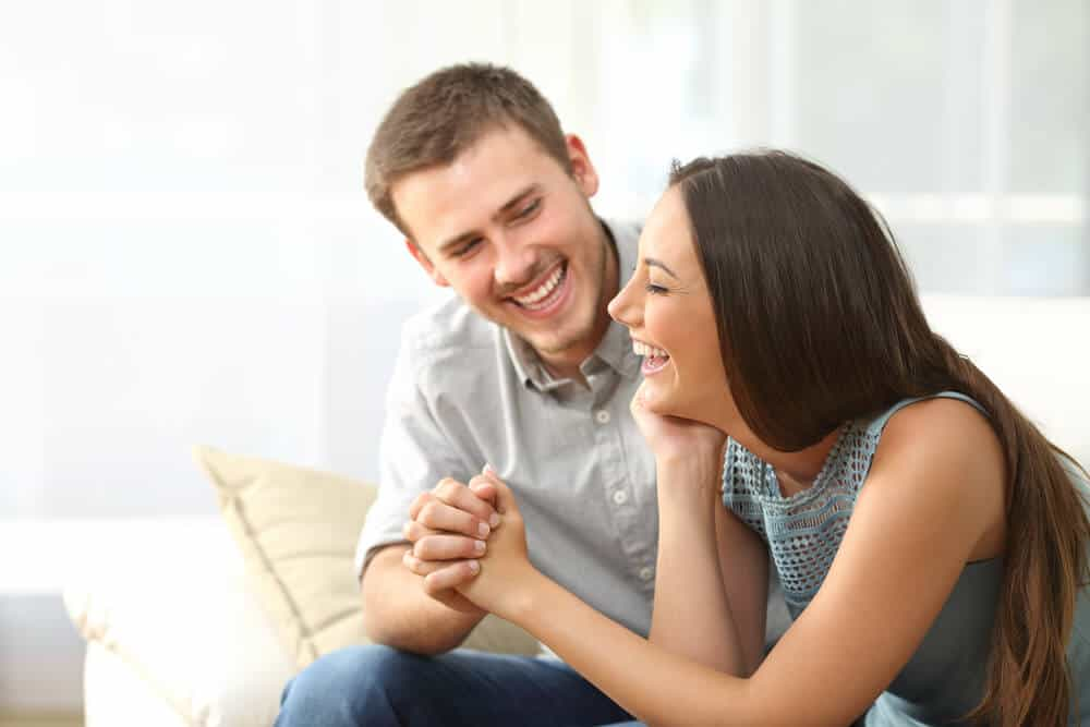man and woman laughing