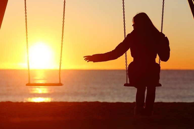 woman alone on a swing