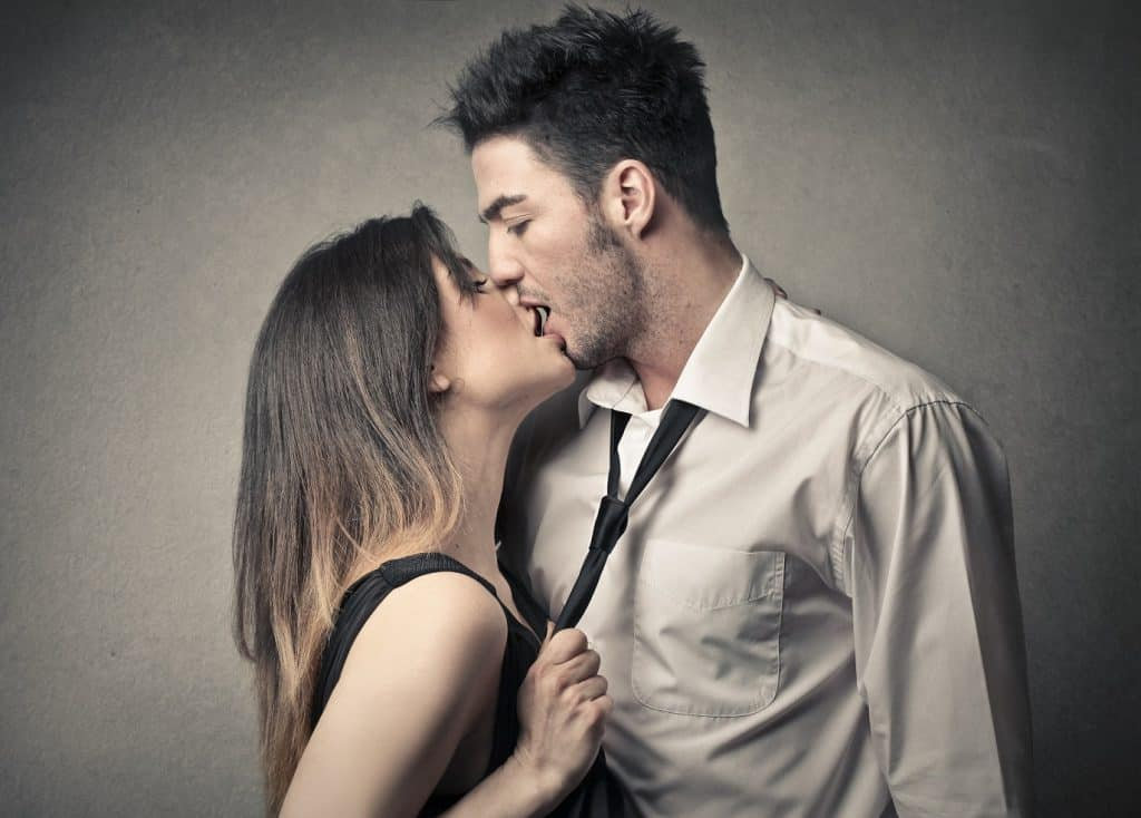 passionate kissing couple grey background
