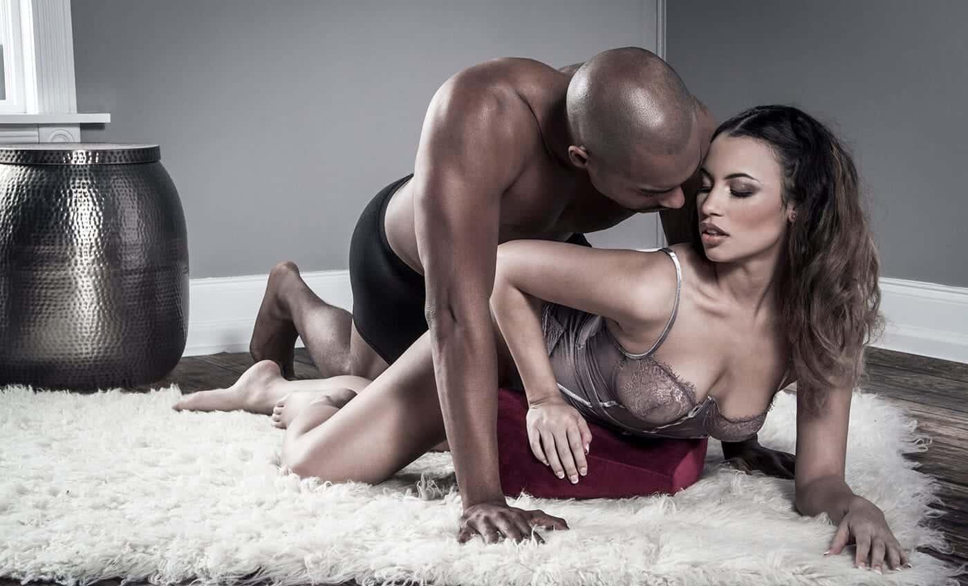 couple having sex on sex pillow