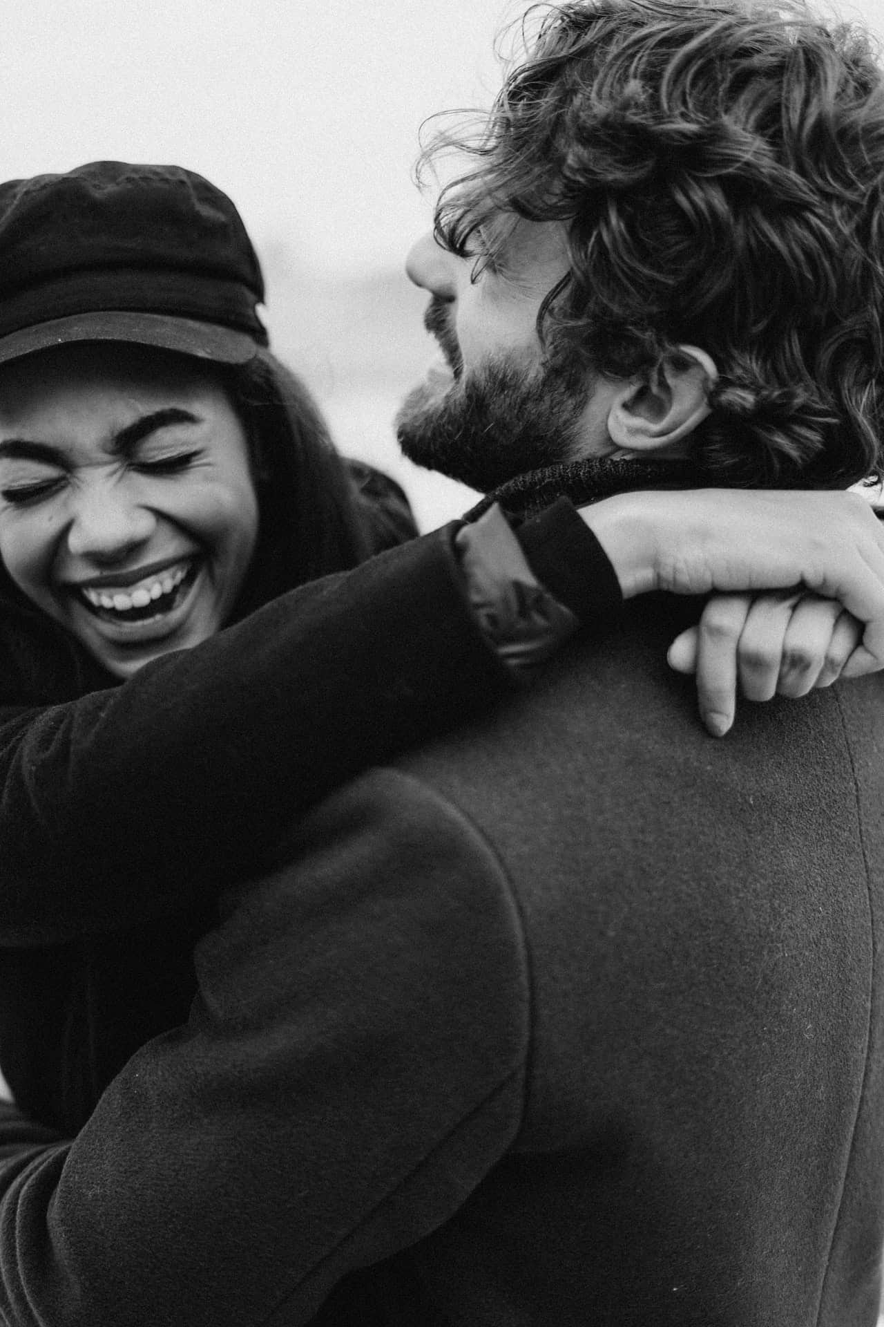 Couple holding each other and laughing together