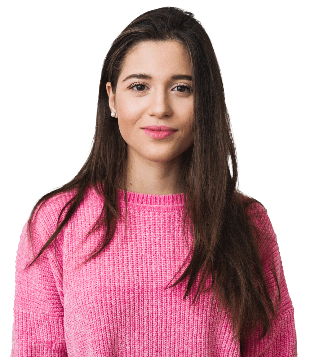 brunette Woman in Pink sweater standning