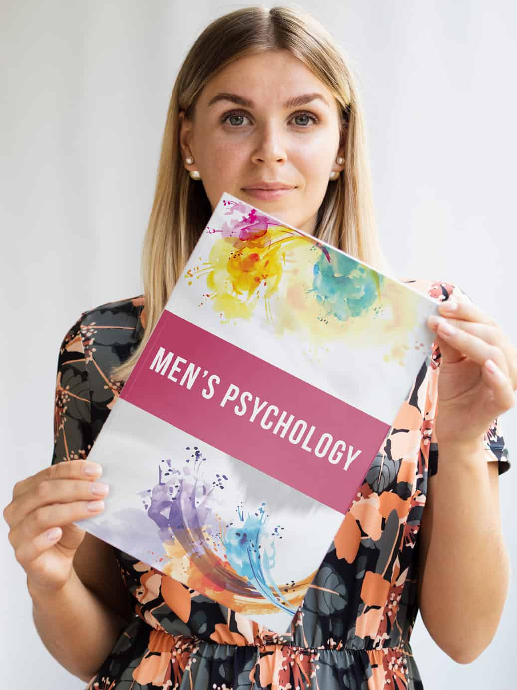 Woman holding 'Men's Psychology' book
