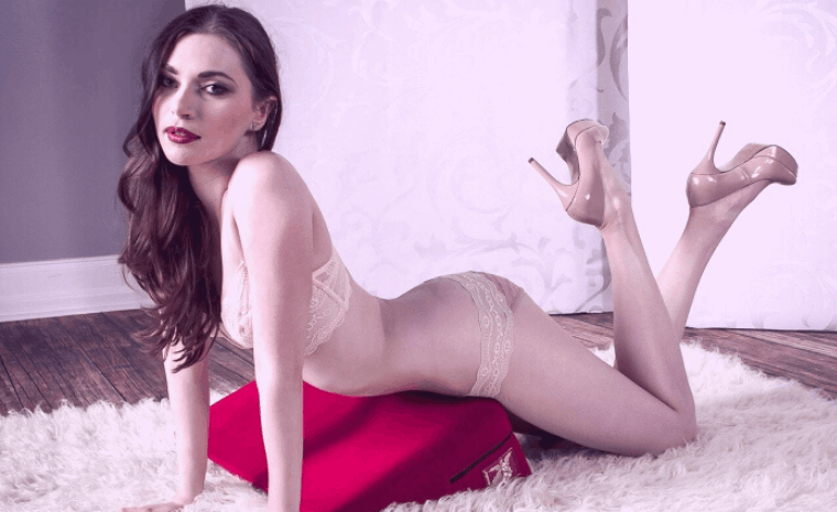woman in lingerie laying on 'wedge' shaped adult pillow