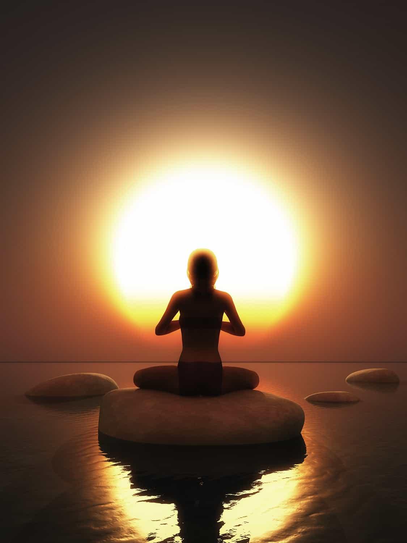 Woman on Rock water Meditate Yoga