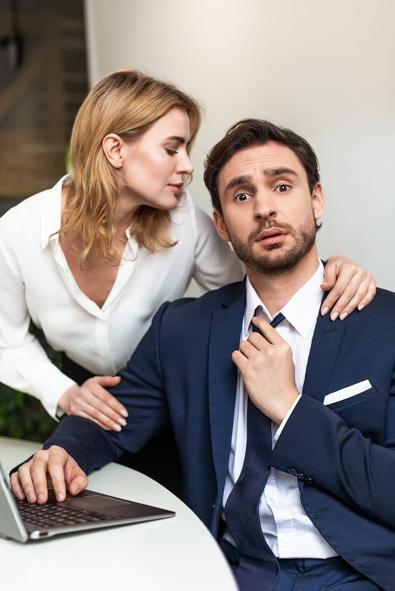 Woman lusting over a man in a business suit