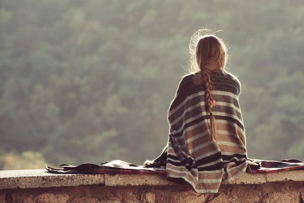Woman alone in nature sad