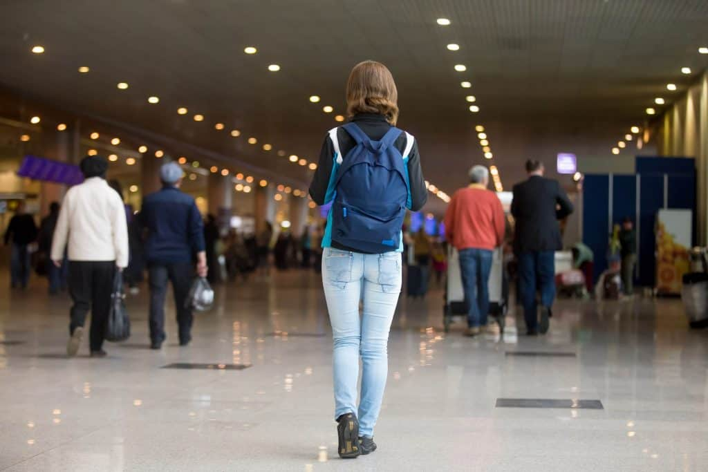 woman with backpack leaving