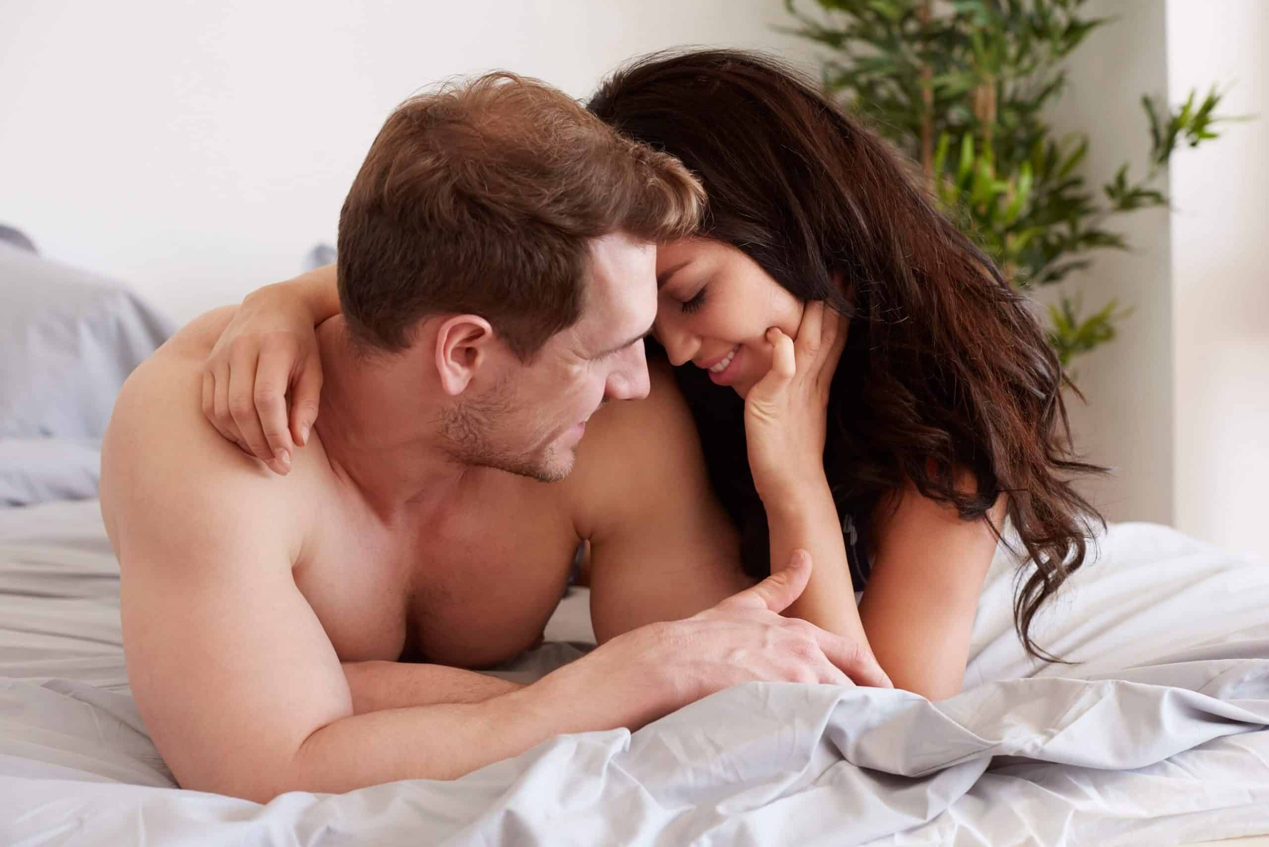 couple intimate on bed