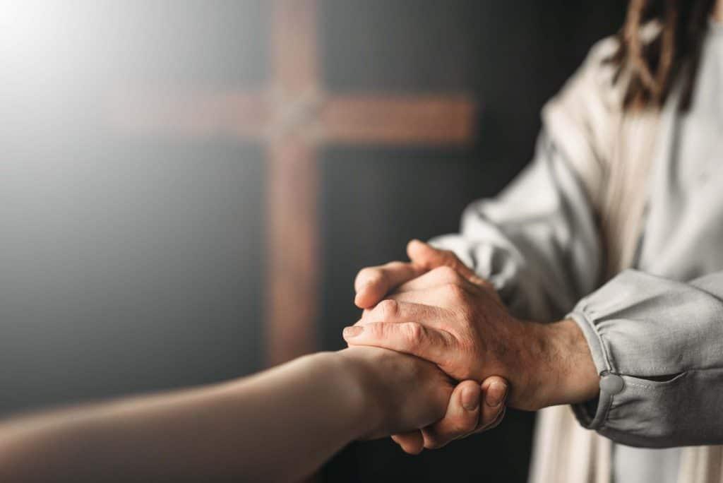 couple hold hands show forgivness