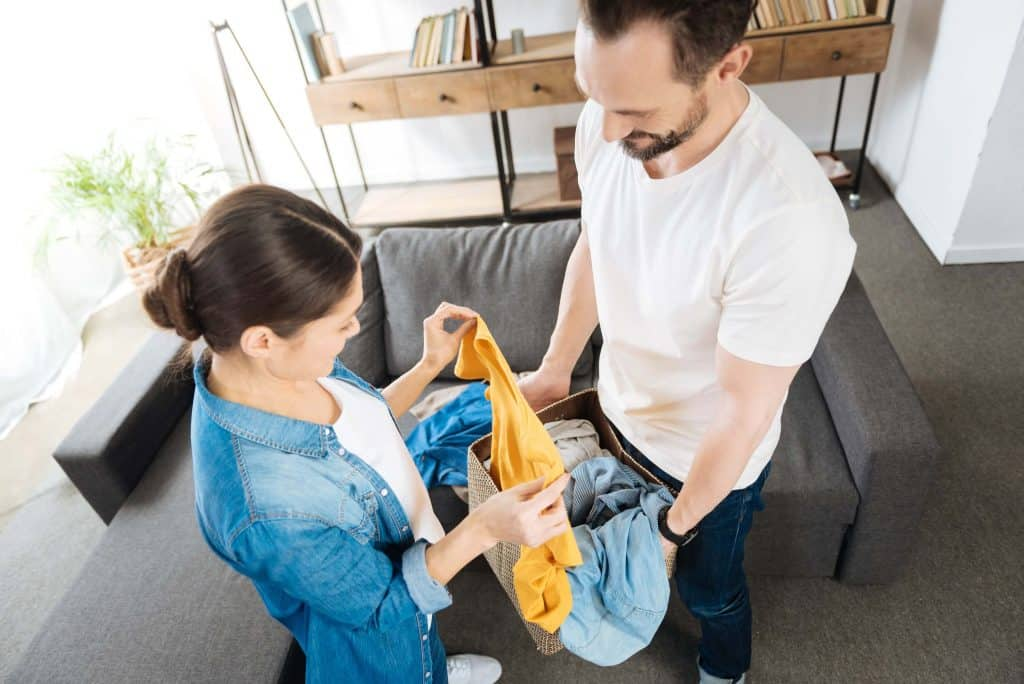 couple doing laundry at home